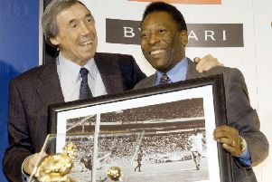 Gordon Banks with a picture of his famous save from Brazil striker Pele. PIC: PA