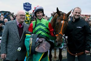 Owner Phil Martin, left, with jockey Danny Cook after Definitly Red's Charlie Hall Chase win (Picture: Richard Sellers/PA Wire).