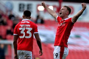 Hero: Cauley Woodrow celebrates scoring Barnsley's second goal against Wycombe Wanderers. Picture: Bruce Rollinson
