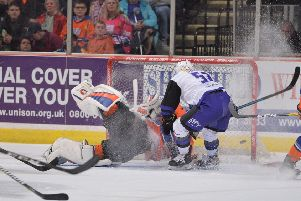 Guillaume Doucet scores past Sheffield Steelers' Jackson Whistle with a simple tap-in for his second goal of the night and Glasgow's fifth (Picture: Dean Woolley).