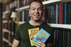 Sir Chris Hoy with his Flying Fergus books. Picture: Ben Duffy/PA.