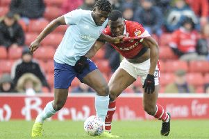 Eyes on the ball: 'Barnsley scorer Dimitri Cavare challenges Offrande Zanzala. Picture: Dean Atkins