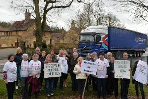 Lorries pass through Hickleton, Yorkshire's most polluted village. 7 March 2019.  Picture Bruce Rollinson