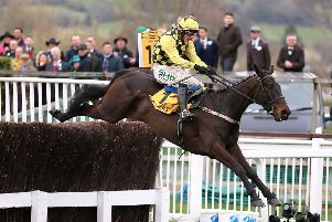 Al Boum Photo and Paul Townend clear the last in the Cheltenham Gold Cup.