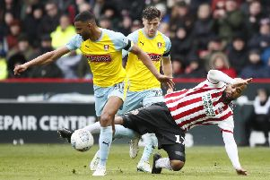 Rotherham United's Michael Ihiekwe, left, duels with Sheffield United's David McGoldrick (Picture: Simon Bellis/Sportimage).