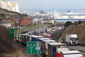 Lorries queue on the A20 to enter the Port of Dover in Kent, as French customs officers continue their work-to-rule industrial action to protest over pay and show the effect Brexit will have on cross-Channel passengers.