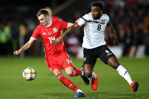 Barnsley winger Ryan Hedges in action for Wales