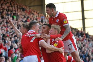 On target: Cauley Woodrow celebrates scoring Barnsley's second goal.  Picture: Bruce Rollinson