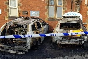 Two police cars were damaged in an arson attack outside Goldthorpe police station this morning (Pic: Martyn Arnold)