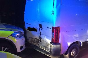 Thieves reverse stolen van into police car injuring two officers. Photo credit: Humberside Police.