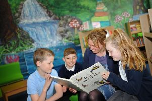 Headteacher Pippa Robinson,with pupils Ryan Elliott, 11, Alfie Buckley, 10, and Ania Sobieralski, nine, at Pheasant Bank Academy, Doncaster