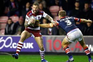 WELCOME BACK: Wigan's Zak Hardaker runs at Sydney Roosters' Mitchell Aubusson during the World Club Challenge match in February. Picture: Martin Rickett/PA