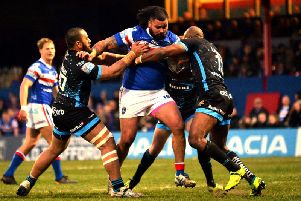 Huddersfield's defence tries to stop the charging Wakefield forward Dave Fifita. (PIC: BRUCE ROLLINSON)