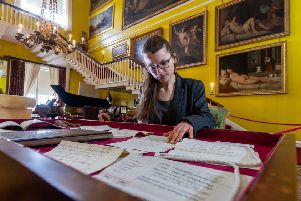FRESH LOOK: Curator Philippa Wood, with documents from a new exhibition taking a fresh look at women branded difficult and meddlesome, at Burton Constable Hall, near Hull. PIC: James Hardisty