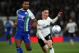 Wigan Athletic's Nathan Byrne and Derby County's Harry Wilson battle for the ball during the Sky Bet Championship match at Pride Park, Derby. Picture: PA