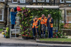 Pictured Sarah Richardson, from Leafy Coulture Flowers, dressing the bus shelter watched by Joseph Lucas, John Leaham, and Steve Matcalfe, from Harrogate Borough Council Parks Department.