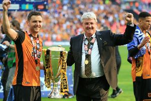 Hull City manager Steve Bruce, right, and his son Alex celebrate after the Championship play-off final win at Wembley in May 2016 (Picture: Nigel French/PA Wire).