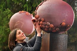 Harrogate artist Anna Whitehouse with her sculpture of two giant spheres adorned with hundreds of individual pollen grains entitled Rhodi Torana. 'Picture Gerard Binks