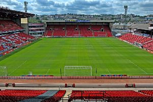 South Yorkshire Police have arrested a man after a racially aggravated assault at Barnsley Football Club.
