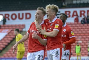 On track: Mike Bahre celebrates his opening goal with Cameron McGeehan before Barnsley progress to a 4-2 win over Fleetwood Town. Picture: Scott Merrylees