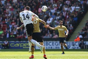 Gary Madine heads at goal against Forest