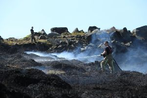 Fire crews battling the fire on Sunday