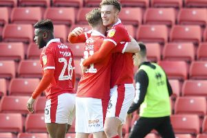 Barnsley's Liam Lindsey is congratulated after scoring the winner at Oakwell. Picture: Dean Atkins