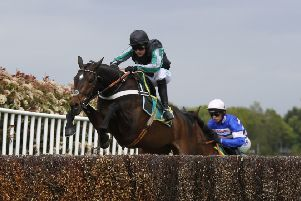 Winners: Nico de Boinville and Altior clear a fence in Sandown's Celebration Chase.