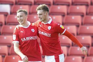 Match-winner: Barnsley's Liam Lindsey is congratulated by Mike Bahre after scoring the winner at Oakwell.