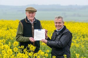 David Kerfoot, chairman of the North Yorkshire and East Riding LEP hands over the open letter, which has been written by the LEPs new initiative, Grow Yorkshire, on behalf of farming and rural communities, to Farming Minister Robert Goodwill. Picture by Scott Merrylees.