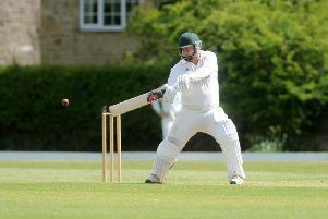 Sam Anderson hits four runs for Collingham and Linton against North Leeds. Picture: Steve Riding.