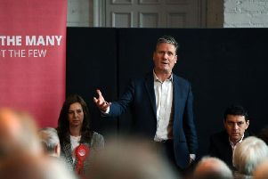 Keir Starmer speaking in Leeds alongside Labour MEP candidate Eloise Todd and Leeds North West MP Alex Sobel. Picture by Jonathan Gawthorpe.