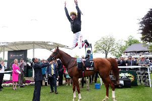 Jockey Frankie Dettori jumps from Stradivarius after winning the MansionBet Yorkshire Cup at the 2018 Dante Festival at York (Picture: Simon Cooper/PA Wire).