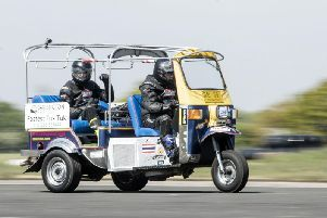 Matt Everard drives his tuk tuk during a world speed record attempt at Elvington Airfield. PIC: Danny Lawson/ PA Wire