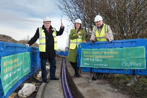 Councillor Peter McBride of Kirklees Council with Kim Johnston and Stephen Moore of CityFibre