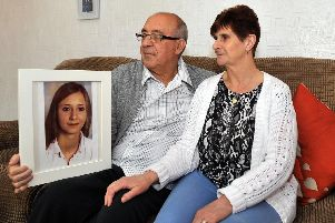 Eileen and Stan Stephenson with a photograph of their daughter Katie, whose organs helped four people.