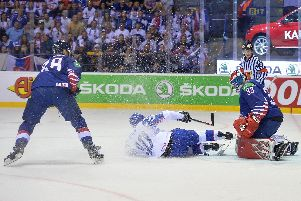 Jackson Whistle, far right, denies a goal for Slovakia in Saturday night's 7-1 defeat in Kosice. Picture: Dean Woolley.