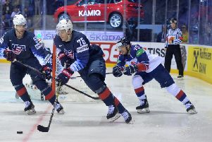 TOUGH GOING: Robert Dowd, far right, tries to stop a breakout from the USA on Wednesday in Kosice; Picture: Dean Woolley.