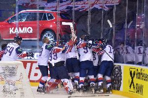 Great Britain's players mob goalscorer Ben Davies (hidden) after his overtime goal ensured they would remain in the top tier of the world championship. Picture: Dean Woolley