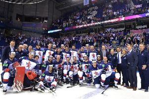 Great Britain's team and staff after retaining place in the top tier of the IIHF World Championships with a 4-3 overtime win against France. Picture: Dean Woolley.