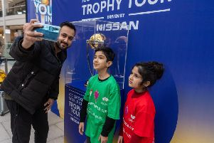 Young fans pose with the World Cup in Leeds ahead of the start of the tournament. Picture: James Hardisty.
