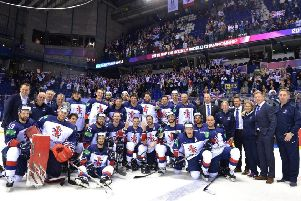 Great Britain's players, officials and staff celebrate their historic win over France in Kosice on Monday night. Picture: Dean Woolley.