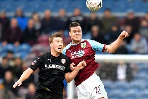 Barnsley's Mike-Steven Bahre, left, duels with Burnley's Kevin Long during the FA Cup tie at Turf Moor in January (Picture: Dave Howarth/PA Wire).