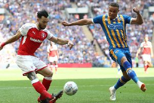 Carlton Morris (right) in action for Shrewsbury Town against Rotherham United in the League One play-off final in May 2018. It was his last competitive appearance due to a serious knee injury.