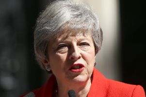 Prime Minister Theresa May making a statement about her departrue outside Downing Street yesterday. Photo: Yui Mok/PA Wire