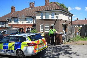 Officers at a property on Gregg House Road. PIC: Danny Lawson/ PA Wire
