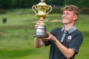 Rotherham's Ben Schmidt beams as he holds the Brabazon Trophy after his win at Alwoodley (Picture: Leaderboard Photography).