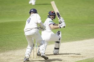 Yorkshire's Adam Lyth hits out against Essex.