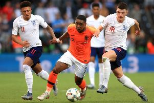 Netherlands' Steven Bergwijn (centre) gets away from England's Declan Rice (right) and Jadon Sancho in Guimaraes. Picture: Mike Egerton/PA