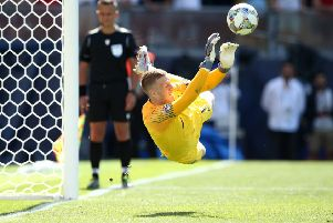 Jordan Pickford saves the decisive penalty from Switzerland's Josip Drmic to give England a 6-5 victory in the penalty shoot-out and third place in the inaugurual UEFA Nations League (Picture: Jan Kruger/Getty Images).